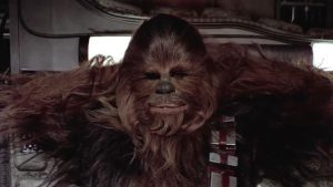 Satisfied Chewbacca with his arms folded behind his head.