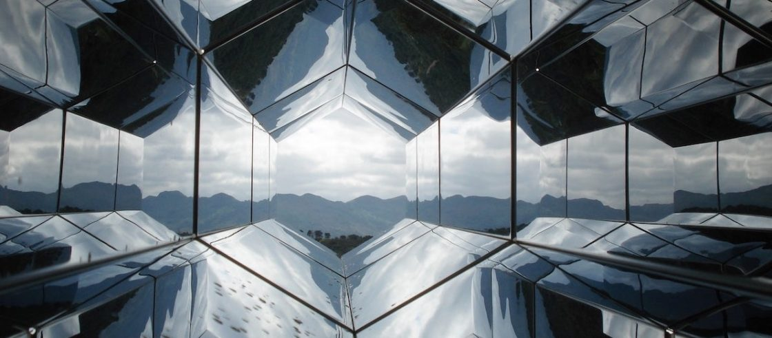 mountain horizon with geometric reflections above and below